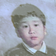 Image depicts Tony Khor - a young Asian American boy with short black hair looking into the camera with stern focus.