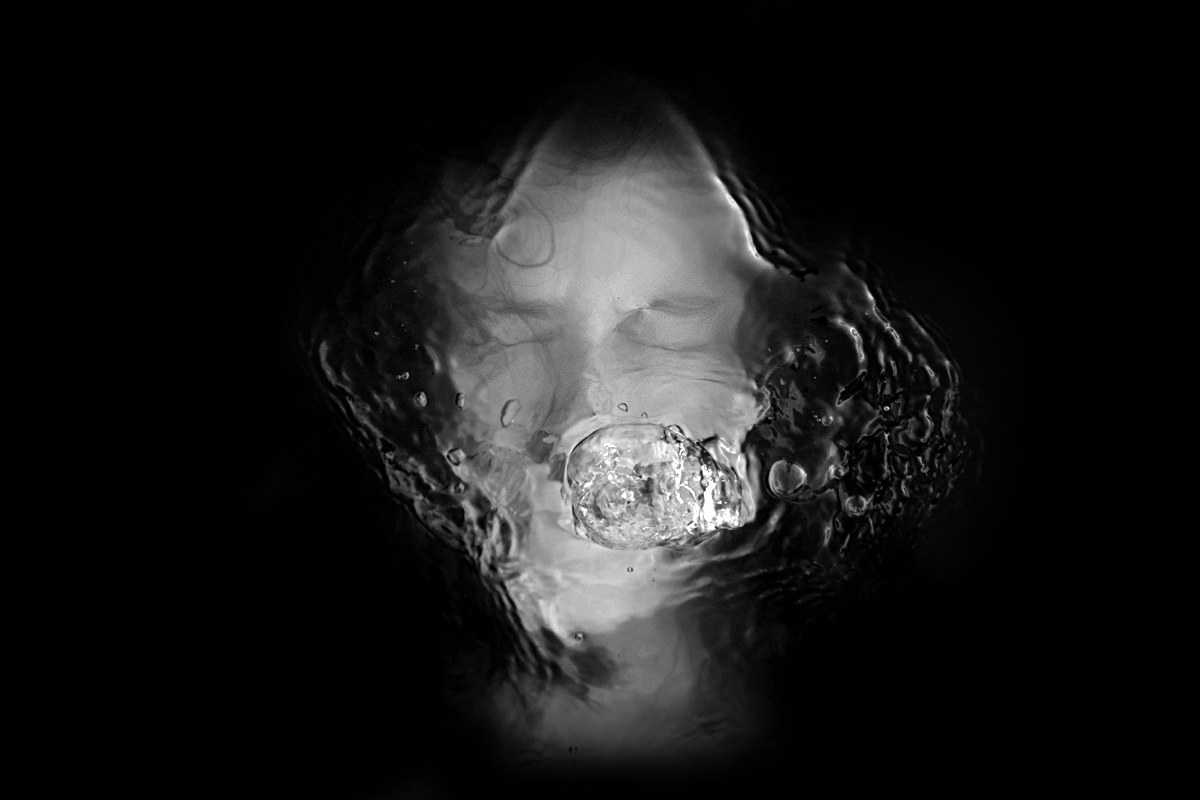 Black water, just under the surface a person silently screaming. Bubbles are raising from the person's mouth towards the water's surface. I visual representation of Selective Mutism.
