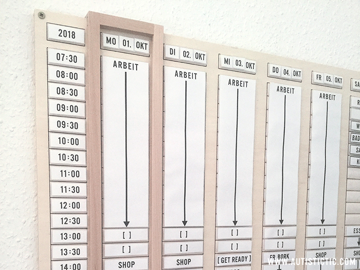 Close up of my planner to show the wooden sliding frame marking the current day.