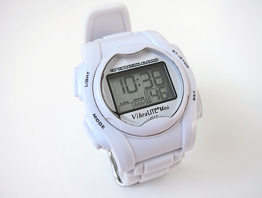 White wrist watch with white silicone band and digital display.